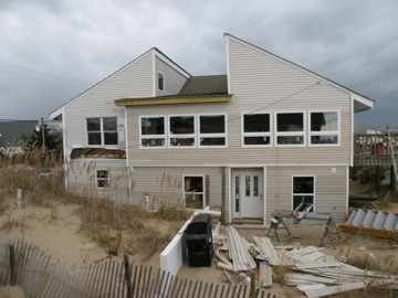 "We'll add a ""Dune Deck"" off the lower entryway"